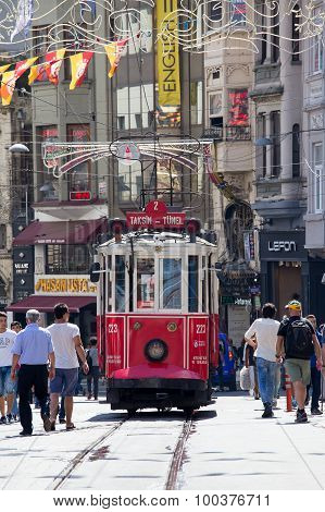 Taksim Tunel Nostalgia Tram Trundles Along The Istiklal Street And People At Istiklal Avenue. Istanb