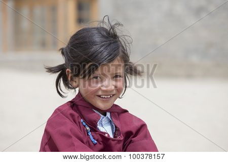 Portrait Of Tibetan Happy Girl In Druk White Lotus School. Ladakh, India