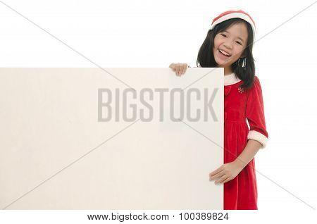 Beautiful asian girl in santa hat and red comforter behind white board onwhite back ground isolated