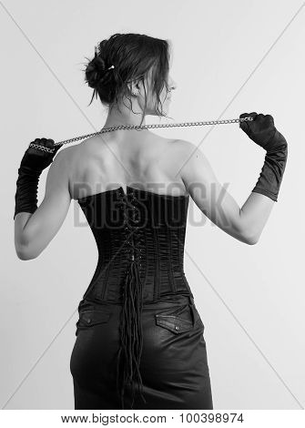 Woman In A Corset And  Chain