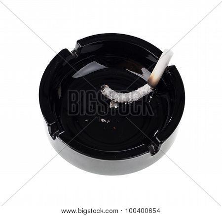 Black ceramic ashtray with cigarette