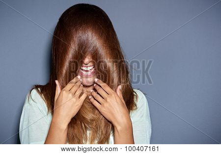 Laughing Young Woman Covering Her Eyes