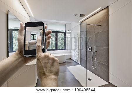 Mobile Device With Man Hands Taking Picture