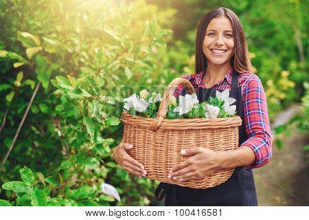 Happy Woman Enjoying Her Work At The Nursery