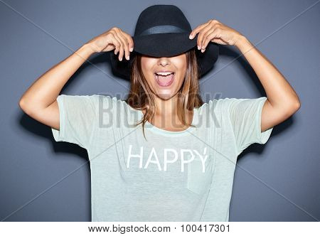 Fun Portrait Of A Young Woman In A Hat