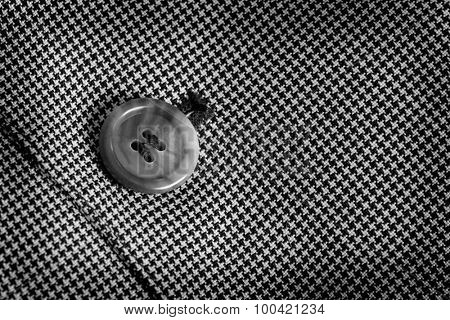 Detail closeup close-up of suit button hole fabric on sleeve of blazer jacket