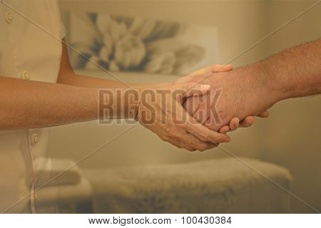 Therapist welcoming new patient