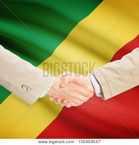 Businessmen shaking hands with flag on background - Republic of the Congo - Congo-Brazzaville poster