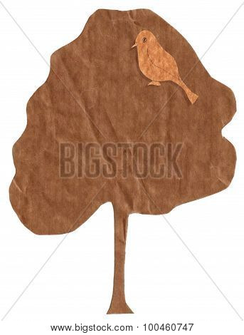 A bird on a tree, brown paper cut outs on a white background