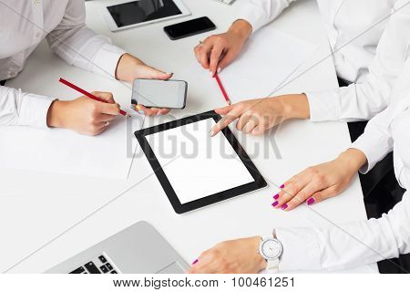 Business women using tablet computer at the meeting