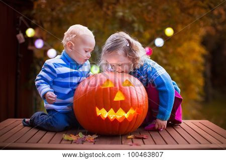 Kids Carving Pumpkin At Halloween
