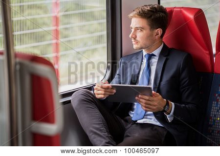 Male Commuter Traveling By Train