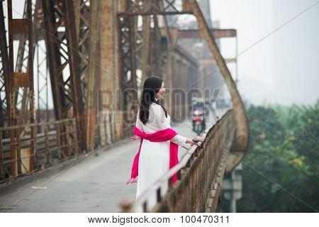 Vietnamese girl on Long Bien bridge in Hanoi, Vietnam