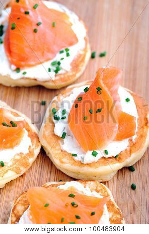 Platter of bite size smoked salmon appetisers suitable for a party