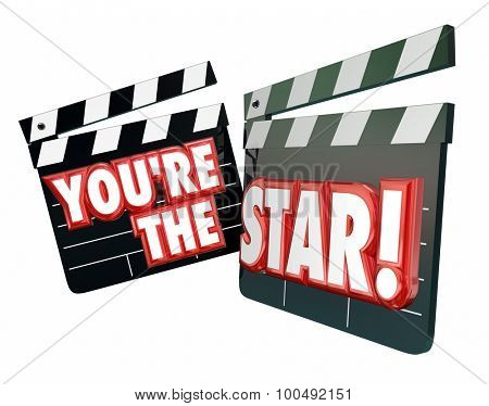 You're the Star words on movie clapper boards to illustrate an actor or actress wth a starring role in a Hollywood production or film poster