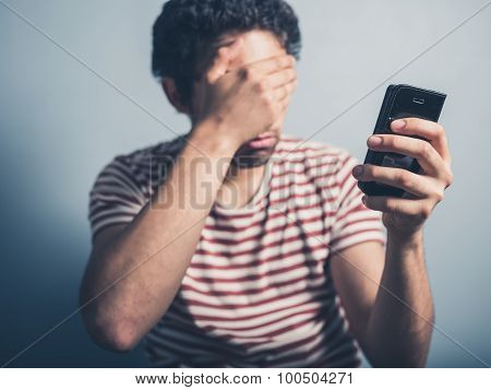 Shocked Man With Smart Phone