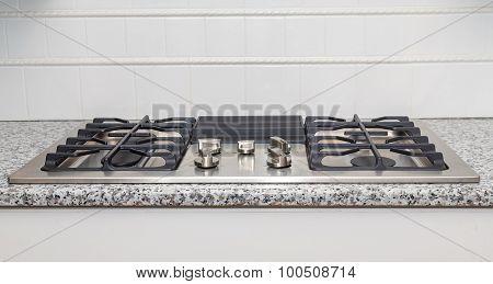 Stainless Steel Cooktop On Granite Countertop