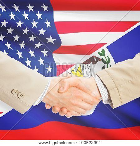 Businessmen shaking hands - United States and Belize poster