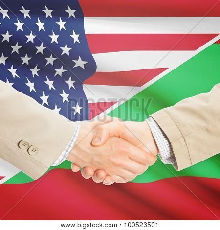 Businessmen shaking hands - United States and Maldives poster