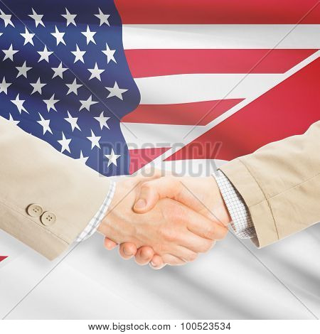 Businessmen shaking hands - United States and Monaco poster