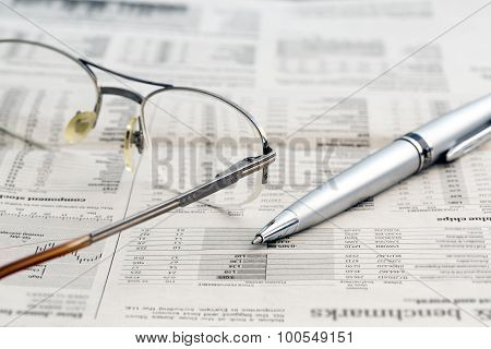 Business newspaper and glasses
