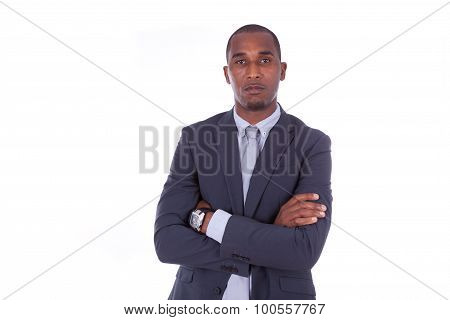 Unhappy African American Business Man With Folded Arms Over White Background - Black People
