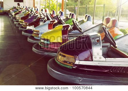 Long Row Of Colorful Bumper Cars Parked In An Amusement Park