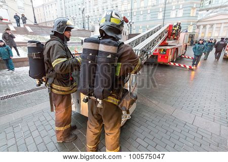 MOSCOW - December 8, 2014: Firemen fold ladder after extinguishing fire in State Academic Bolshoi Theatre of Russia Historical scene