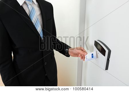 Businessperson Hands Holding Keycard