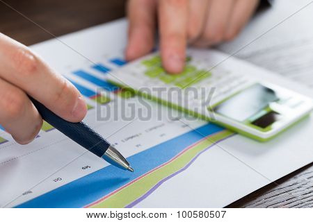 Person Hands Analyzing Financial Report