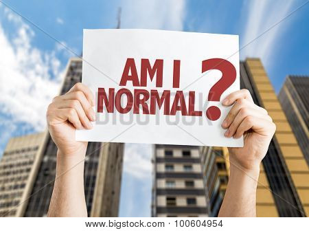 Am I Normal? placard with cityscape background