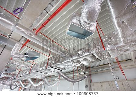 Ceiling under construction. Network of hvac and fire fighting system on the future store ceiling poster
