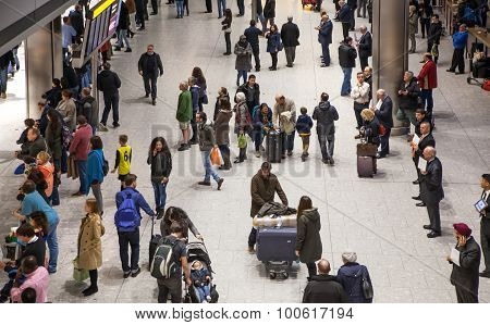 LONDON, UK - MARCH 28, 2015: People waiting for arrivals in Heathrow airport Terminal 5