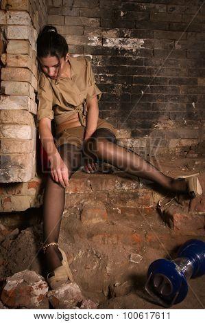 Lifeless  Woman Sitting On The Stone Floor (imitation)