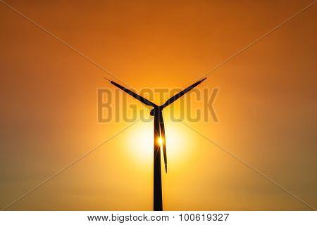 Wind Turbine Power Generator At Sunset