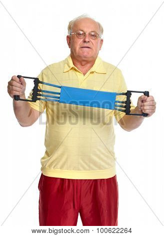 Elderly man with chest expander. Isolated white background.