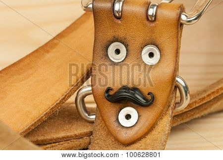 Sofia, Bulgaria - 4 September, 2015: Belt rivets with fake mustache for the Movember event