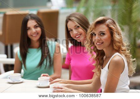 Beautiful young women in cafe