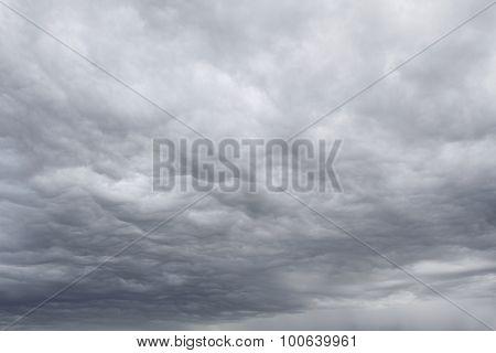 Dark ominous grey storm clouds. Dramatic sky