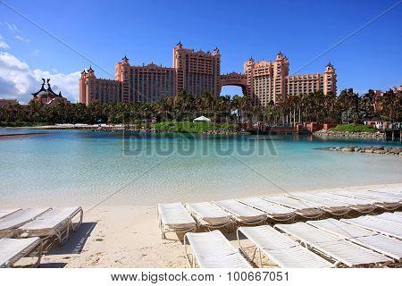 Sun blue sky and puffy clouds at Atlantis hotel Paradise Island Bahamas poster