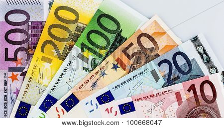 euro banknotes are adjacent. symbolic photo for earnings, sales and cash poster