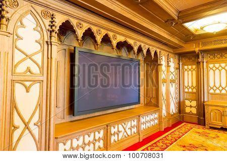 Novi Petrivtsi, Ukraine - May 27, 2015 Mezhigirya residence of ex-president of Ukraine Yanukovich. Modern home theater room interior with big TV set