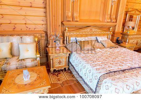 Novi Petrivtsi, Ukraine - May 27, 2015 Mezhigirya residence of ex-president of Ukraine Yanukovich. Cozy bedroom with modern interior