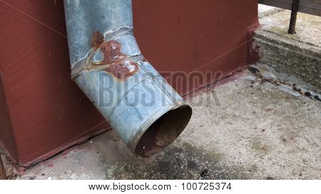 old rusty gutter metal rain drain pipe on the wall poster
