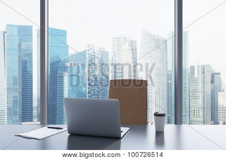 A Workplace In A Modern Panoramic Office With Singapore View. A Grey Table, Brown Leather Chair. Lap