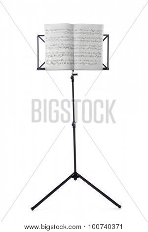 Music sheets on stand isolated on white