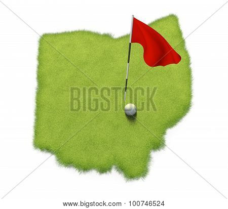 Golf ball and flag pole on course putting green shaped like the state of Ohio