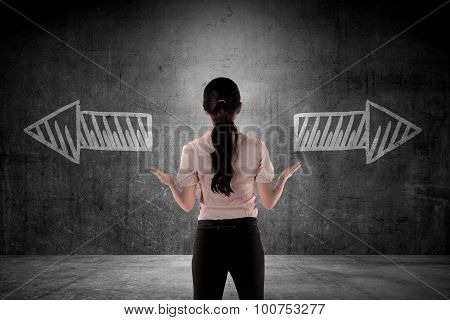 Business Woman Has To Choose Between Two Way