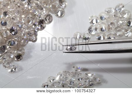 Selected round and Marquise diamond shape with tweezers. poster