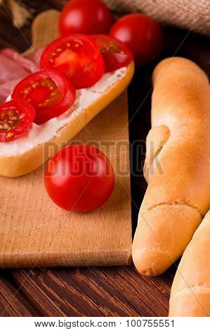 Red Cherry Tomato Between Rolls And Baguette